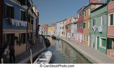 Colourful houses and canal in Burano island, Italy - Scene...
