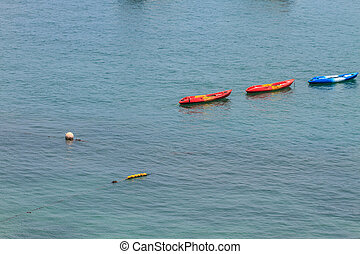 Colourful kayaks on tropical sea