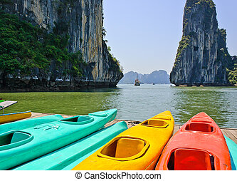 Colourful kayaks with limestone mountains background at ...