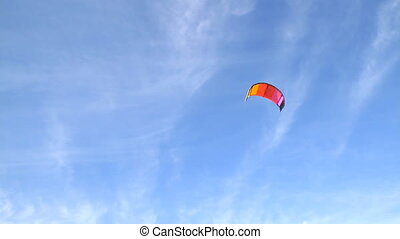 Colourful  kite  flies on the blue sky