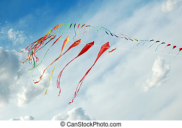 colourful kites in cloudy sky