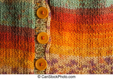 colourful knitted cardigan with buttons background