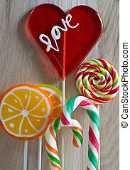 Colourful lollipop on wooden backgr