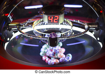 Colourful lottery balls in a lotto machine 42