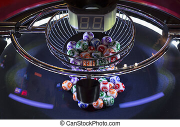 Colourful lottery balls in a lotto machine