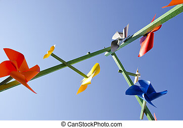 paper windmills on sky background