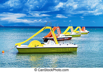 Colourful pedalos in the water on a beautiful summer day
