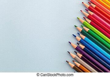 colourful pencils at a slant