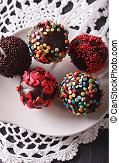 Pop cakes closeup on a white plate on the table. vertical -...