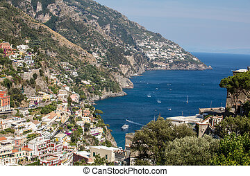 Colourful Positano, the jewel of the Amalfi Coast, with its multicoloured homes and buildings perched on a large hill overlooking the sea. Italy