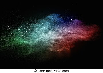 Colourful powder exploding isolated on black