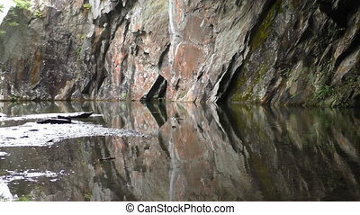 Colourful rock water reflection