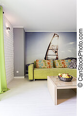 Colourful room with windsurfing themed wallpaper