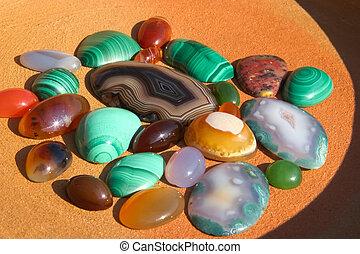 Colourful semiprecious stones a-cornelian, malachite, onyx