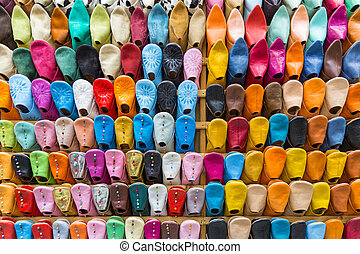 Colourful Slippers wall - Front view of colourful Moroccan...