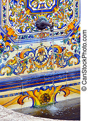 Colourful Spanish tiles decoration on water faountain