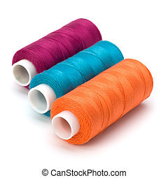 Colourful spools of thread isolated on white background