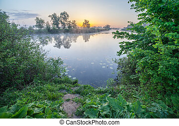 Colourful sunset on the river. The Ukraine