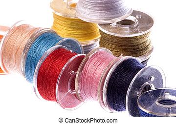 Colourful Thread Bobbins Macro Isolated