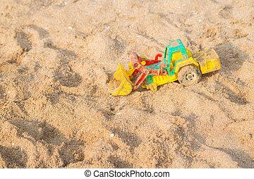 Colourful Toy car on the sand beach