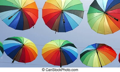 Colourful umbrellas against blue sky
