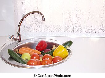 Colourful vegetables and fruits in a sink