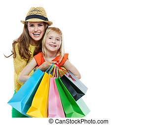 Portrait of happy mother hugging daughter with shopping bags