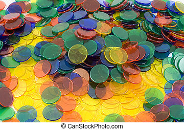 Colourfull Counters on a white background, mixed up colours