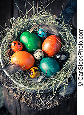 Colourfull Easter eggs in the rustic cottage