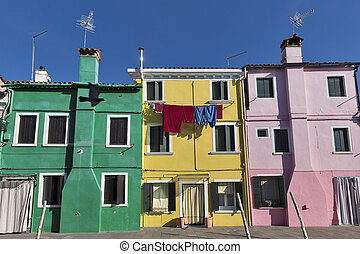 Colourfully painted houses on Burano, Italy.