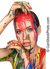 Colours paint dripping down on face.