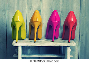 Colours - Retro photo of pink, yellow and red shoes