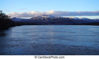 Columbia River Flows under Snow Covered Ridge Washington -...