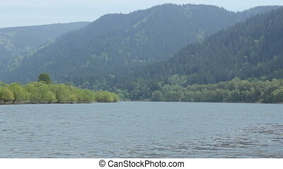 Columbia River Gorge showing the Oregon side with forested...