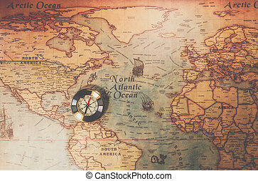 Columbus day and world map with compass