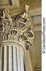 Column capital close up - architectural element of antique buildings decoration