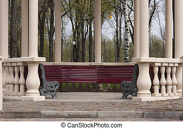 Column gazebo with empty benches in the park