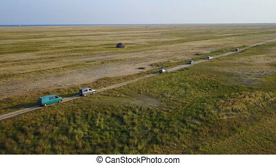 Column of auto tourists. Aerial survey - The column of auto...