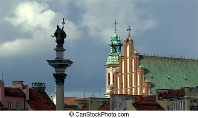 Statue of Zygmunt III Vasa atop of the Zygmunt's column and St John's Archcathedral in Old Town Warsaw, Poland.