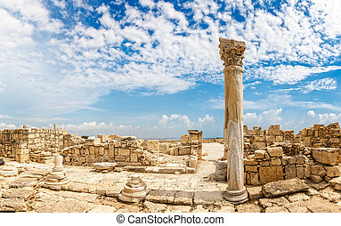 Columns and ruins of ancient Kourion with clouds and blue ...