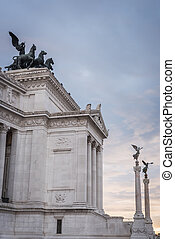 Columns and statues at the entrance of the Vittorio Emanuele II monument in Rome