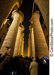 Columns in an ancient egyptian temple at night