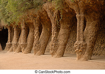 Columns in Park Guell designed by Antoni Gaudi in Barcelona Spain