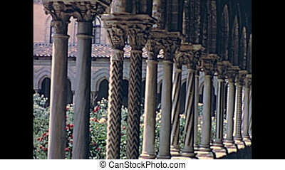 columns of the monastery cloister: Chiostro dei Benedettini of Monreale town in Palermo province. Historical archival of Palermo city of Sicily Italian island in the 1960s.