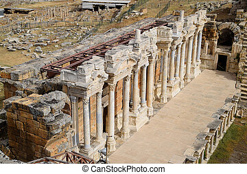 Columns on the stage of the amphitheater. Ancient antique amphitheater in city of Hierapolis in Turkey.