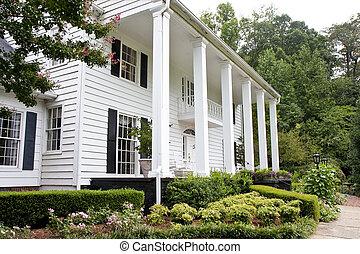 Columns on White Siding House