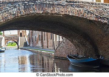 Comacchio (Ferrara, Emilia Romagna, Italy) - Bridges over a canal with boats