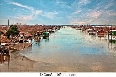 Comacchio, Ferrara, Italy: fishing huts in the lagoon -...