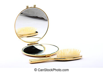 comb and looking-glass over white