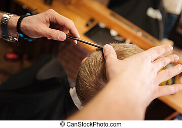 Comb being used by a professional barber